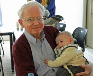Partner Richard Ogle with Jane Edgerton's grandson, Reeves, at one of the firm's Thanksgiving lunches.